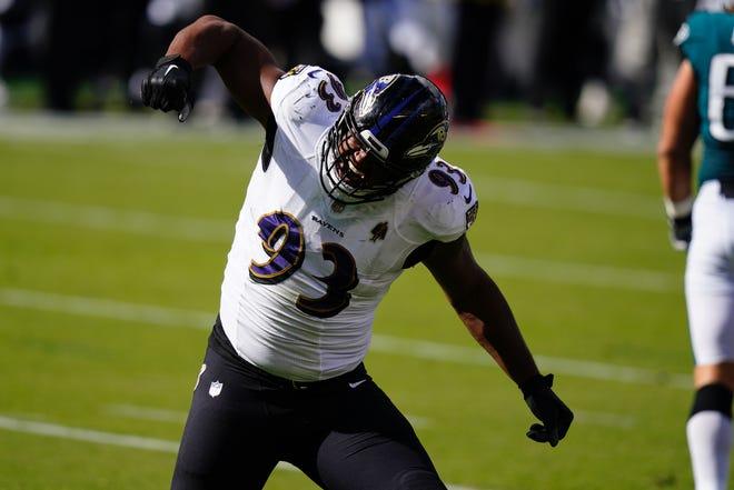 Ravens defensive lineman Calais Campbell celebrates one of his two first-half sacks of Eagles quarterback Carson Wentz on Sunday.