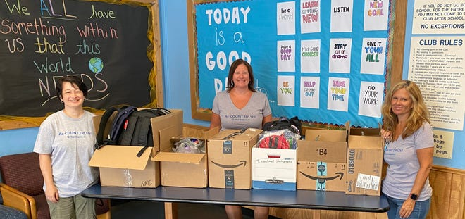 DunlapSLK PC, the Chalfont-based certified public accounting and consulting firm, donated backpacks and school supplies for the North Penn Valley Boys & Girls Club's members. The club serves nearly 4,000 children and teens between the ages of 6 and 18 each year. From left: DunlapSLK team members Karin Honeybone, Darla Tate and Brenda Freed.