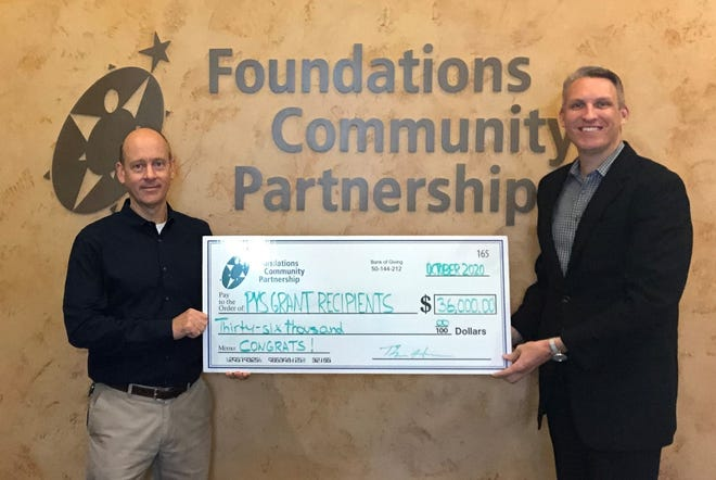 Foundations Community Partnership invested $36,000 in grant funding to 12 Bucks County non-profit organizations. Pictured, from left, Tom Hanna, chair of FCP's board of directors and Executive Director Dr. Tobi Bruhn.