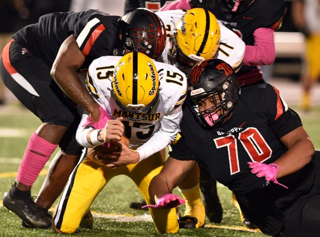 Aliquippa defensive end Karl McBride and defensive tackle Naquan Crowder (70) combine to sack Montour quarterback Luke Persinger in a Week 6 win over the Spartans.