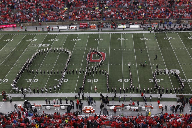 The Ohio State Marching Band performs Script Ohio at Ohio Stadium before the start of the OSU vs Wisconsin football game on October 29, 2019. [Karl Kuntz Dispatch]