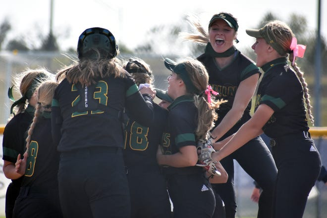 Members of the Rock Bridge softball team celebrate after clinching the Class 5 District 4 championship on Saturday at Troy Buchanan High School.