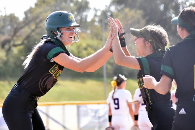 Rock Bridge's Maddie Snider, left, high fives Bruin teammate Taylor Nivens, right, after Snider hit a home run during the Bruins' MSHSAA Class 5 District 4 championship game against Troy Buchanan.