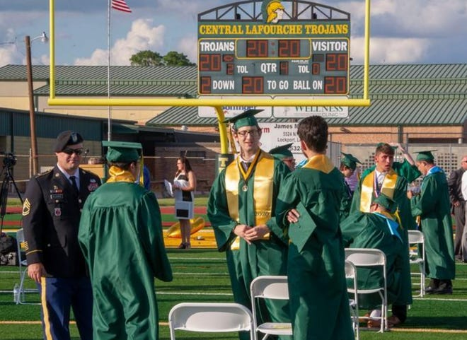 Graduates chat after Central Lafourche High's commencement May 28 at the school's stadium in Mathews.