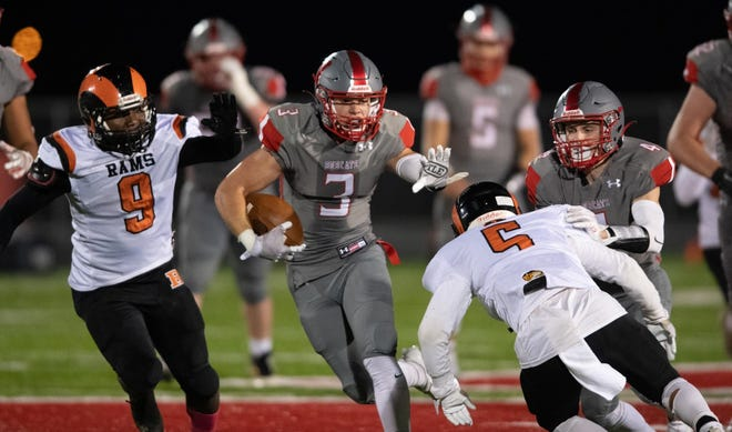 Hayden Tanner avoids a tackler during one of his long runs against Mineral Ridge. Tanner went for 98 yards and three TDs on just five carries.