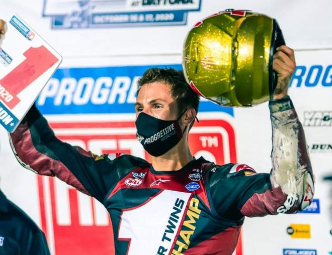 Briar Bauman celebrates his American Flat Track SuperTwins championship at Daytona International Speedway Saturday night.