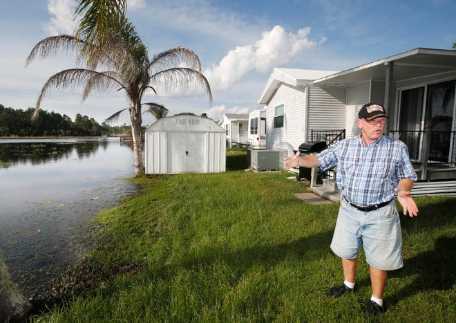 Stephen Booth talks about the encroachment of Little Lake on the backyard of his Osteen home in Kove Estates, Friday, Oct. 16, 2020. Residents of Kove Estates have repeatedly expressed concerns about the impact development in the area could have on the lake's levels.