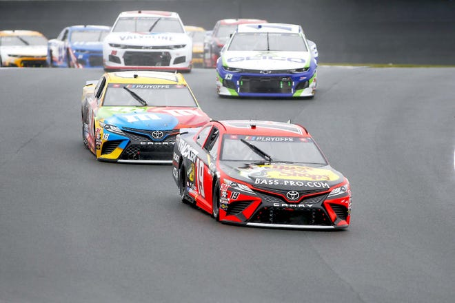 Martin Truex Jr (19) competes in a Cup Series race at Charlotte Motor Speedway in Concord, North Carrolina, Oct. 11.
