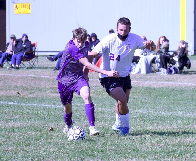 West Canada Valley Indian Kolby Weakley and Little Falls Mountie Tanner Zacek (from left) compete for position and possession of the ball during the second half of play Saturday.