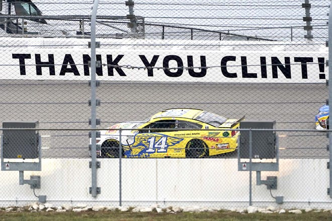 Clint Bowyer drives past a message about his last season during Sunday's Cup Series race at Kansas Speedway in Kansas City, Kansas.