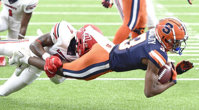 Syracuse wide receiver Taj Harris is tackled after a reception against Liberty during the first half of Saturday's game at the Carrier Dome in Syracuse, New York.