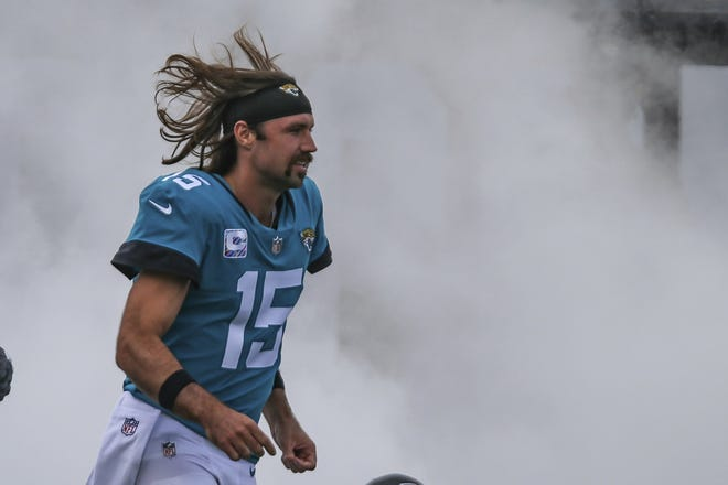 Jaguars' quarterback Gardner Minshew, seen here running onto the field to start Sunday's game against the Detroit Lions, seems at a loss along with everybody else for how to get this team to snap out of a five-game losing streak.