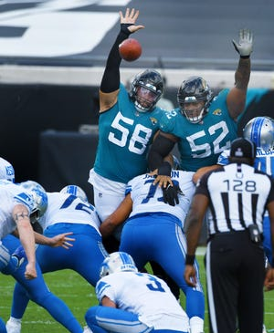 Jaguars tackle Doug Costin (58) has been a valuable contributor on defense and special teams this season.