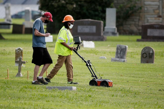 Workers use ground penetrating radar as work continues in July on a search for a potential unmarked mass grave from the 1921 Tulsa Race Massacre, at Oaklawn Cemetery in Tulsa, Okla. A second excavation begins Monday at a cemetery in an effort to find and identify victims of the 1921 Tulsa Race Massacre and shed light on violence that left hundreds dead and decimated an area that was once a cultural and economic mecca for African Americans.
