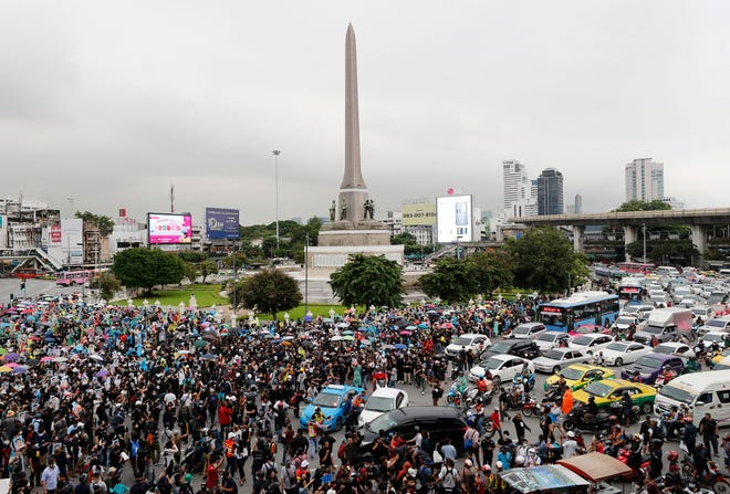 Pro-democracy protesters gather at Victory Monument in Bangkok, Thailand, on Sunday. Thai police on Sunday declined to say whether they were taking a softer approach toward student anti-government demonstrations, after several mass rallies attracting thousands of protesters ended peacefully in Bangkok on Saturday.