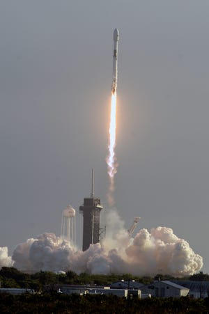 A SpaceX Falcon 9 lifts off from Pad 39A at Kennedy Space Center on Sunday.