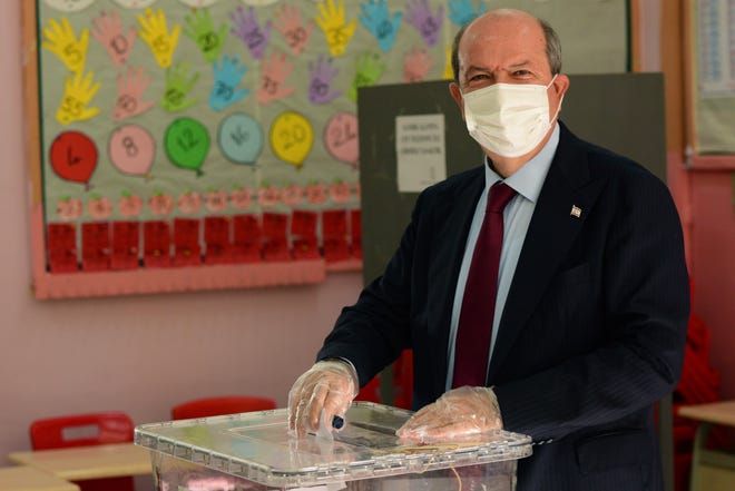Ersin Tatar, candidate and prime minister of a self-declared Turkish Cypriot state recognized only by Turkey, casts his ballot at a polling station in the Turkish occupied area in the north part of the divided capital Nicosia, Cyprus, on Sunday.