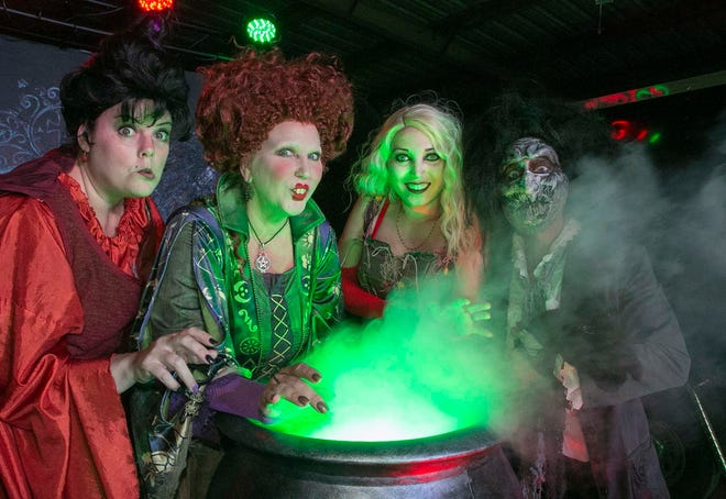 """CosFX Studios cast members, left to right, Jaimz Dillman, Kimberly Zurzolo, Kyla Swanberg and Rob Sims delight fans while dressed as characters from the movie """"Hocus Pocus"""" during the Hocus Pocus movie event at the Silver Moon Drive-In Theatre in Lakeland Oct. 17."""