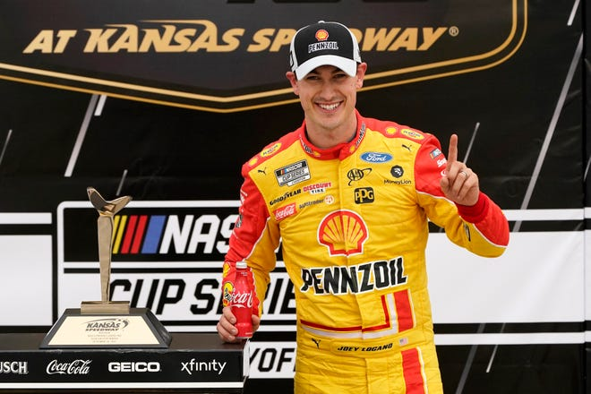 Joey Logano celebrates in victory lane after winning a NASCAR Cup Series auto race at Kansas Speedway in Kansas City, Kan., on Sunday.
