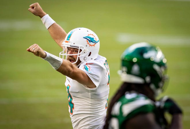 Miami Dolphins quarterback Ryan Fitzpatrick (14) celebrates a touchdown pass to Miami Dolphins tight end Durham Smythe (81) in the second quarter to give the Dolphins a 21-0 lead against the New York Jets at Hard Rock Stadium in Miami Gardens, October 18, 2020.  [ALLEN EYESTONE/The Palm Beach Post]