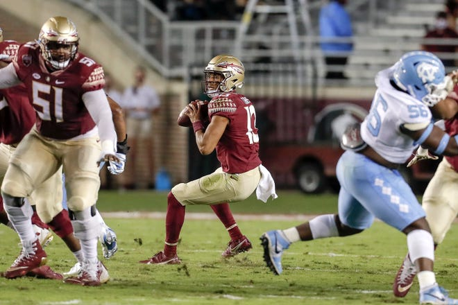Former Benjamin standout Jordan Travis passes against North Carolina during Florida State's upset Saturday night at Doak Campbell Stadium.