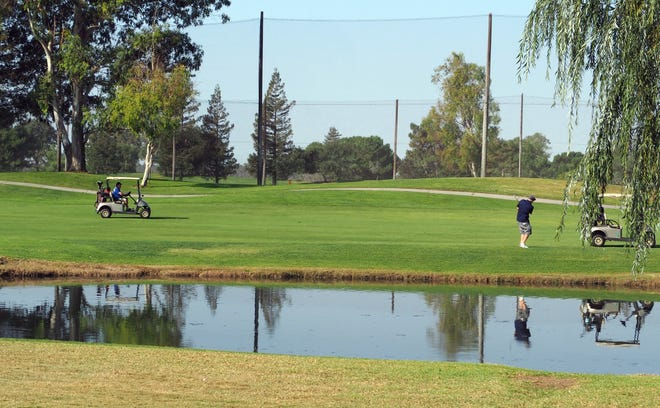 Golfers near the lake at hole number 3e at Micke Grove Golf Links located 11401 N. Micke Grove Road south of Lodi.