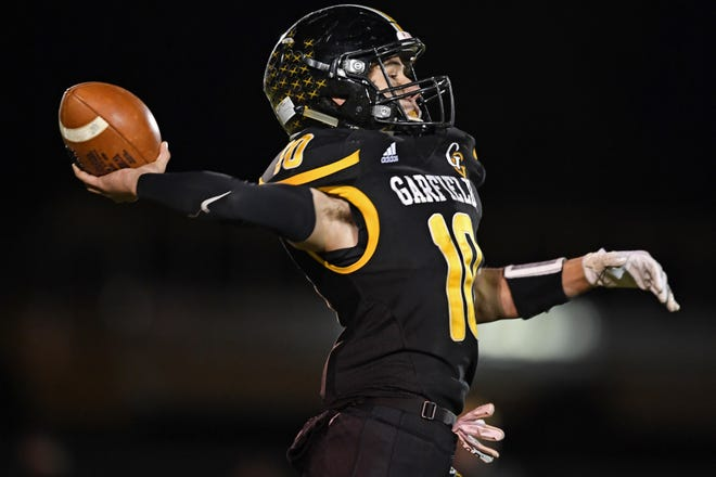 Garfield's Brody Swigowski throws a pass during the second half of Saturday night's OHSAA playoff game. Garfield won 24-21.