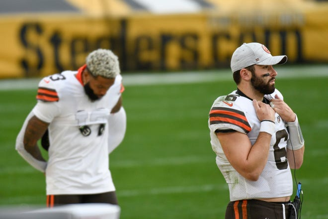 Cleveland Browns quarterback Baker Mayfield (6) and wide receiver Odell Beckham Jr. (13) on the sideline during the second half of an NFL football game against the Pittsburgh Steelers, Sunday, Oct. 18, 2020, in Pittsburgh. (AP Photo/Don Wright)