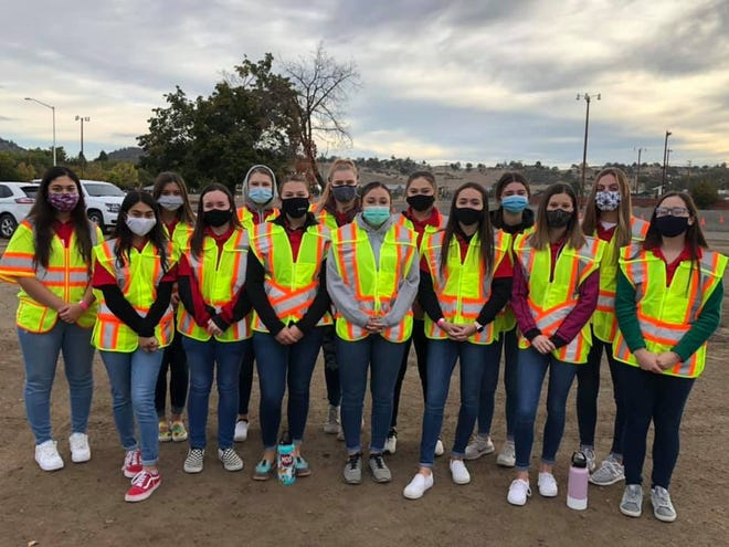 A total of 14 students from Yreka High School volunteered at the Siskiyou County Public Health's annual drive through flu clinic.