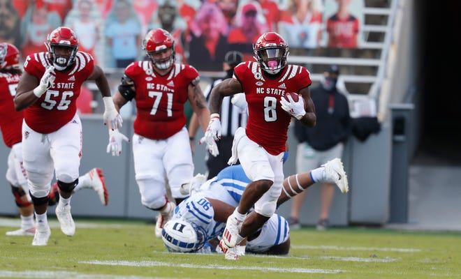 N.C. State running back Ricky Person Jr. (8) gains yards during the first half of N.C. State's game against Duke at Carter-Finley Stadium in Raleigh, N.C., Saturday, Oct. 17, 2020.
