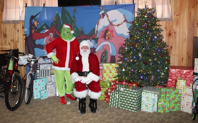 The Grinch and Santa delivered gifts last year for Project Grinch Dust.