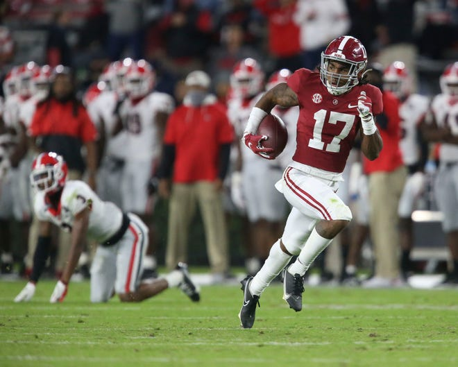 Oct 17, 2020; Tuscaloosa, Alabama, USA; Alabama wide receiver Jaylen Waddle (17) catches a pass after Georgia defensive back Tyson Campbell (3) fell. Waddle turned the catch into a 90 yard touchdown during the second half of Alabama's 41-24 win over Georgia at Bryant-Denny Stadium. Mandatory Credit: Gary Cosby Jr/The Tuscaloosa News via USA TODAY Sports