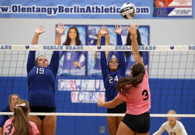 Ready's Megan Chesser (left) and Ava Peoples leap to block Olentangy Berlin's Emmy Bush during a 25-10, 25-12, 25-12 loss to the Bears on Oct. 12. The Silver Knights opened the Division III district tournament Oct. 24.