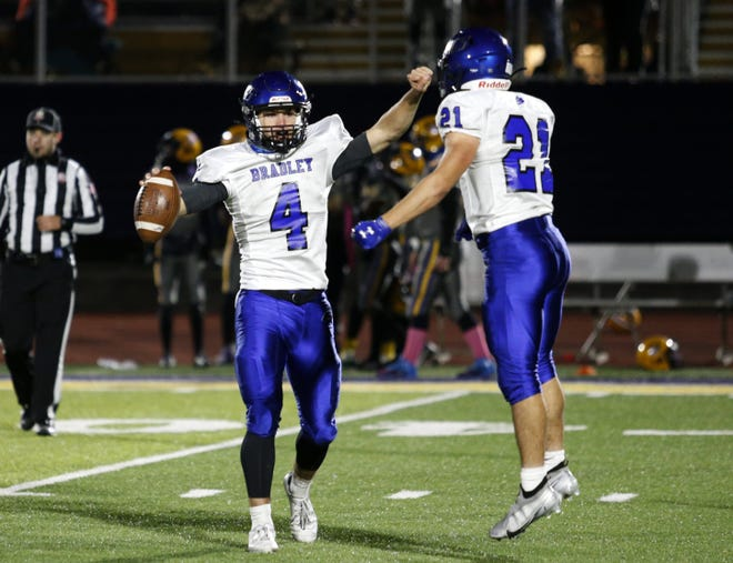 Bradley quarterback A.J. Mirgon celebrates a 31-30 playoff upset of Reynoldsburg with teammate Trevor Schuler on Oct. 16. Mirgon, a senior, led the Jaguars in rushing and passing heading into a matchup at Pickerington Central on Oct. 23.