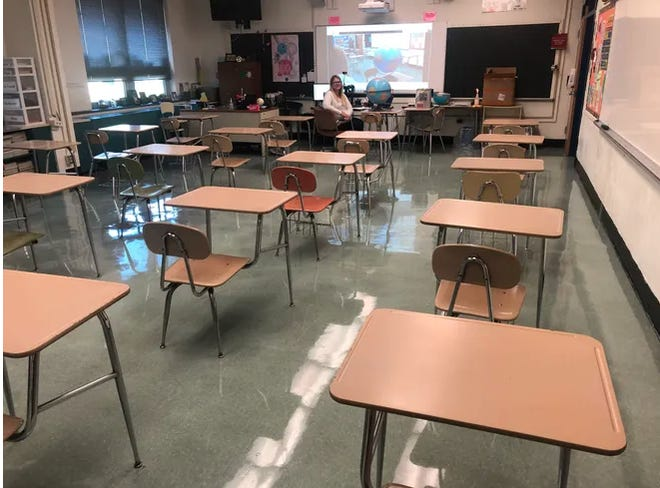 Desks are spread out in a classroom at Chambersburg Area Middle School North. Most extra furniture has been removed from classrooms as students in the Chambersburg Area School District begin to return.