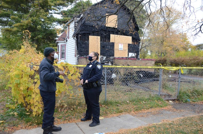 An investigation is underway after fire early Sunday heavily damaged a home where Battle Creek police believe two people were killed Oct. 7.  (Trace Christenson/The Enquirer)