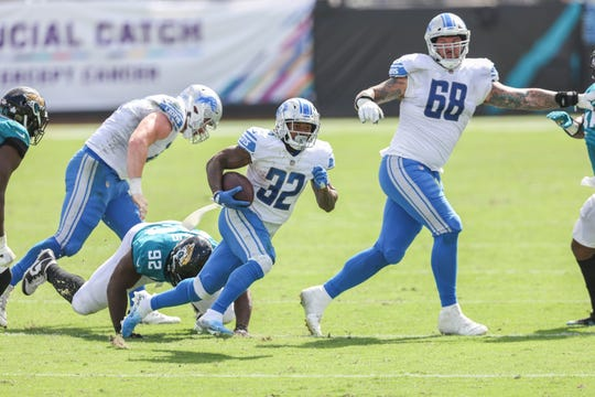 The Detroit Lions' D'Andre Swift ran the ball in the second quarter of a game against the Jacksonville Jaguars at the TIAA Bank Field on October 18, 2010 in Jacksonville, Florida.