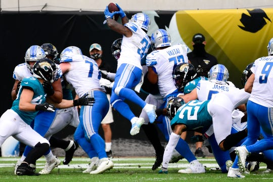 The Detroit Lions running back D'Andre Swift leaps over the pile for a touchdown against the Jacksonville Jaguars in the first half at TIAA Bank Field, October 18, 2020.