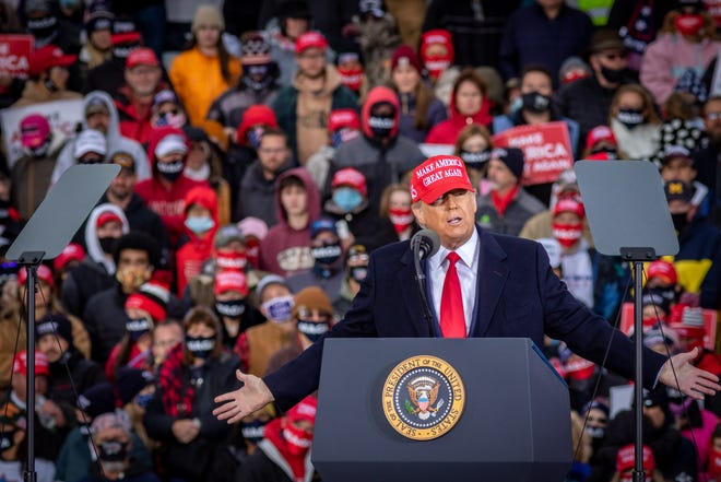 U.S. President Donald Trump speaks to supporters at a rally at Muskegon County Airport in Muskegon on Oct. 17, 2020.