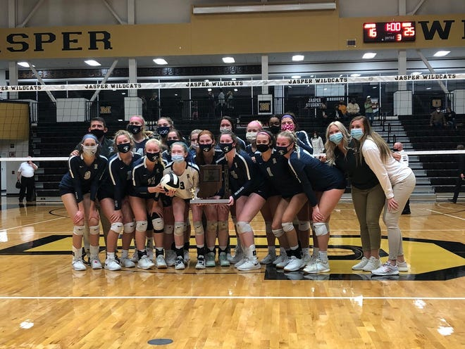 The Reitz volleyball team poses with the championship trophy after winning their first ever sectional title.