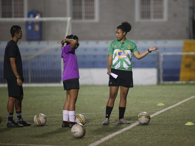 "Kiarra Hutcherson, in green top, conducts a practical session during a GFA ""D"" Coaching License Course at the GFA National Training Center in this Aug. 3 file photo. The next GFA ""D"" Coaching License Course will be reserved for women only beginning Oct. 23, thanks to funds from the new FIFA Women's Football Development Program."