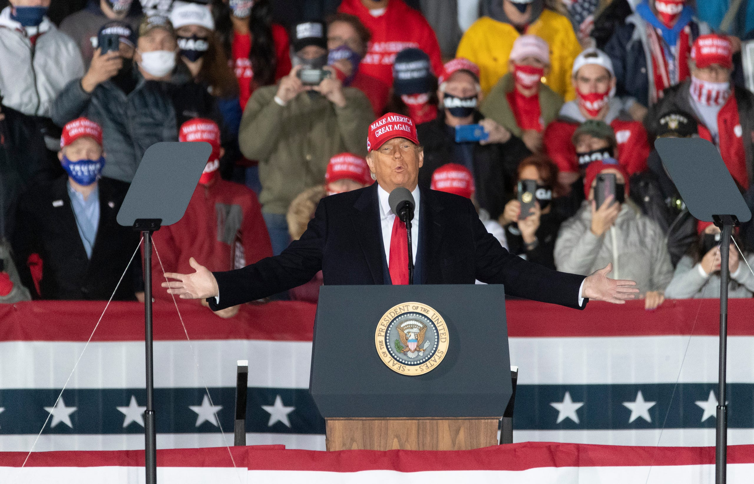 President Donald Trump speaks at a campaign appearance Saturday, Oct. 17, 2020, at the Southern Wisconsin Regional Airport in Janesville. Thousands of Trump's fans, many of them without masks, welcomed the president on an airport tarmac Saturday evening as coronavirus cases soared across Wisconsin.