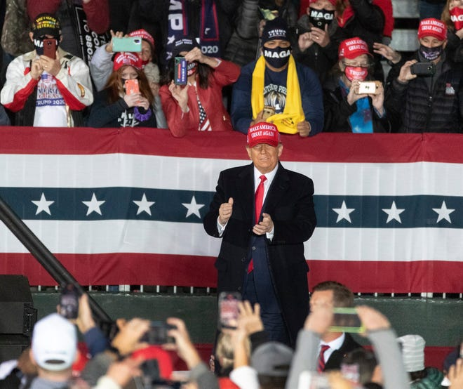 President Trump arrives at a campaign appearance Saturday in Janesville.