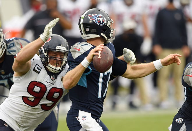 Houston Texans defensive end J.J. Watt (99) forces Tennessee Titans quarterback Ryan Tannehill (17) to fumble and the ball was recovered by the Texans during the third quarter at Nissan Stadium Sunday, Oct. 18, 2020 in Nashville, Tenn.