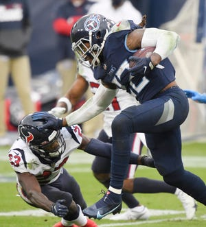 Tennessee Titans running back Derrick Henry (22) leaps over Houston Texans free safety Eric Murray (23) to score a touchdown Oct. 18 in Nashville, Tenn. The Titans (6-2) host the Indianapolis Colts (5-3) Thursday night in an AFC South battle.