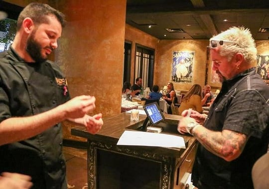 Celebrity chef Guy Fieri autographed menus when he visited Pazzo! Cucina Italiana in Naples on Oct. 17, 2020. (Photo courtesy of Samantha Bloom)