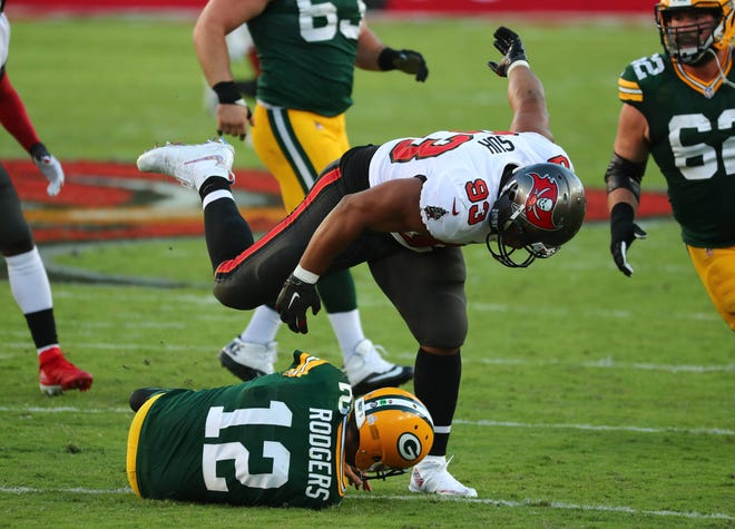 Tampa Bay Buccaneers defensive end Ndamukong Suh (93) sacks Green Bay Packers quarterback Aaron Rodgers (12) during the second quarter of a NFL game at Raymond James Stadium.