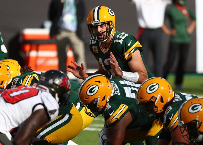 Green Bay Packers quarterback Aaron Rodgers (12) calls a play against the Tampa Bay Buccaneers during the first quarter of a NFL game at Raymond James Stadium.