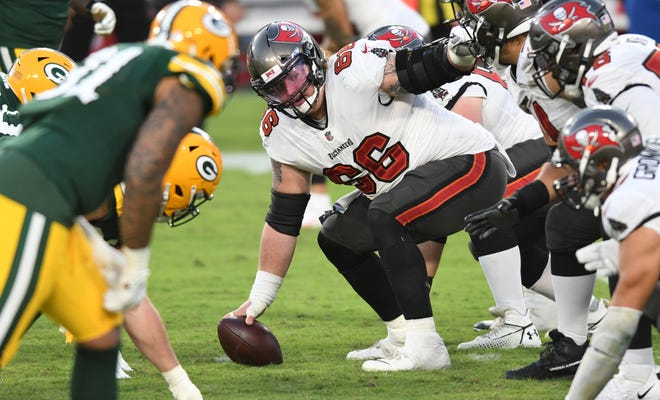 Tampa Bay Buccaneers center Ryan Jensen (66) calls a play against the Green Bay Packers during the second half of an NFL football game Sunday, Oct. 18, 2020, in Tampa, Fla.