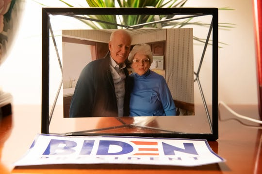 A photo of Anne Kearns with Joe Biden, taken earlier this year, is displayed on a table in Kearns' Scranton, Pa., home on Wednesday, October 14, 2020. Biden spent the first 10 years of his life growing up in the house.